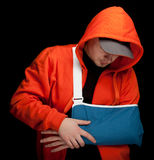 Young man with broken hand Royalty Free Stock Image