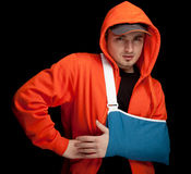 Young man with broken hand wearing Stock Photos