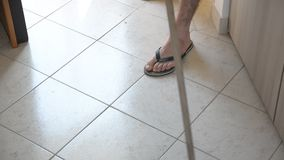 Young Man with Broom Sweeping the Floor stock footage