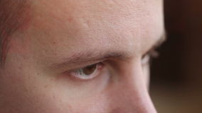 A young man with brown eyes looking to the side ,a computer effect.  stock footage