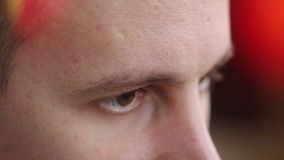 A young man with brown eyes looking to the side ,a computer effect.  stock video footage