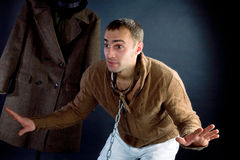A young man in a brown jacket Stock Photos