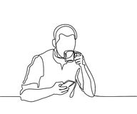 Young man browsing cell phone and drinking coffee Stock Image