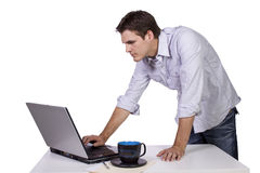 Young man browsing internet on laptop Royalty Free Stock Photo