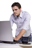 Young man browsing internet on laptop Stock Image