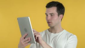 Young Man Browsing Internet, Using Tablet. The Young Man Browsing Internet, Using Tablet, high quality stock video