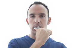Young man brushing his teeth Royalty Free Stock Images