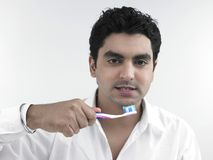 Young man brushing his teeth Stock Photos