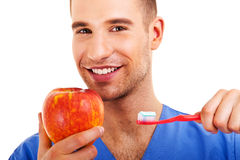 A young man brushing his teeth Stock Image