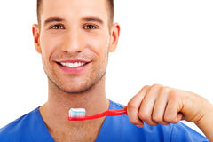 A young man brushing his teeth Royalty Free Stock Photography