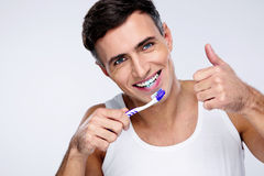 Young man brushing his teeth Stock Image
