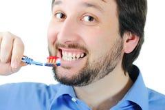 Young man brushing teeth Royalty Free Stock Image