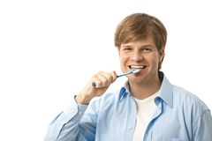 Young man brushing teeth Royalty Free Stock Photography