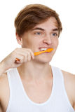 Young man brushing teeth close up shoot Royalty Free Stock Image