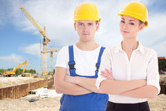 Young man builder and business woman architect in helmet Royalty Free Stock Images