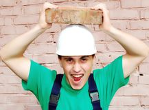 Young man in a builder uniform. Stock Photos