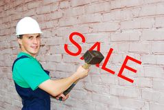 Young man in a builder uniform. Stock Image