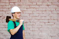 Young man in a builder uniform. Royalty Free Stock Image