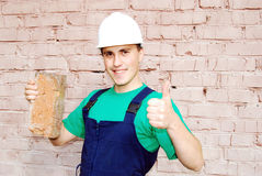 Young man in a builder uniform. Royalty Free Stock Photo