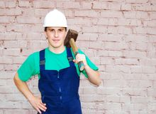 Young man in a builder uniform. Stock Photography