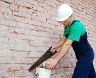 Young man in a builder uniform. Royalty Free Stock Photography