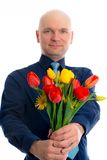 Young man with bunch of tulips Stock Photo