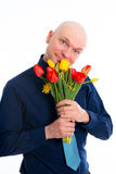 Young man with bunch of tulips Stock Photos