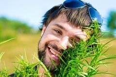 Young man in the bush of cannabis Royalty Free Stock Photo