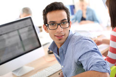 Young man in business apprenticeship on computer Stock Photo