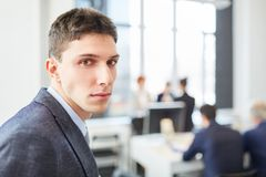 Young man in business apprenticeship. Young man or student in business apprenticeship at start-up company royalty free stock photography