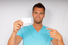 Young man with business card Royalty Free Stock Photos