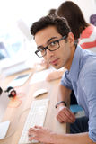 Young man in business class Stock Photo