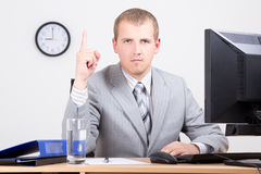 Young man with business idea sitting in office Stock Photos