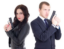 Young man in business suit and elegant woman with guns isolated Stock Images