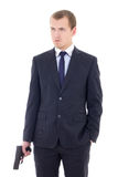 Young man in business suit with handgun isolated on white Royalty Free Stock Image