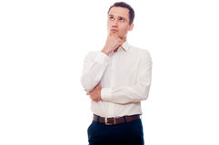 Young man in business suit thinking. Businessman making decision. Man looking up isolated on white Stock Photos