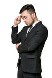 Young man in business suit, thinking about something, isolated on a white background Royalty Free Stock Photos