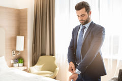 Young man business traveler hotel room accomodation. Young male business traveler hotel accomodation dress royalty free stock photo