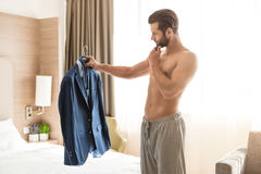 Young man business traveler hotel room accomodation Royalty Free Stock Photo