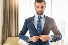 Young man business traveler hotel room accomodation. Young male business traveler hotel accomodation dress royalty free stock photos