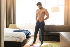 Young man business traveler hotel room accomodation. Young male business traveler hotel accomodation dress stock photo
