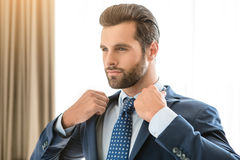Young man business traveler hotel room accomodation Stock Images
