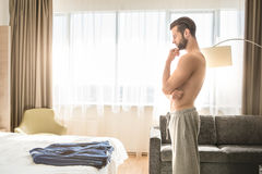 Young man business traveler hotel room accomodation Stock Image