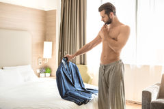 Young man business traveler hotel room accomodation. Young male business traveler hotel accomodation dress royalty free stock photography