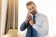 Young man business traveler hotel room accomodation. Young male business traveler hotel accomodation phone call Royalty Free Stock Photos