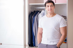 The young man businessman getting dressed for work Royalty Free Stock Photos