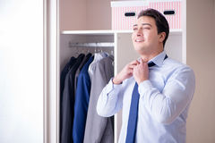 The young man businessman getting dressed for work Stock Photos