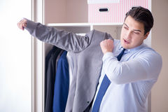 The young man businessman getting dressed for work Royalty Free Stock Image