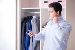 The young man businessman getting dressed for work Royalty Free Stock Images