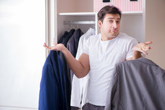 The young man businessman getting dressed for work Royalty Free Stock Photography